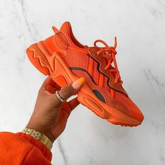 помаранцеві кросівки